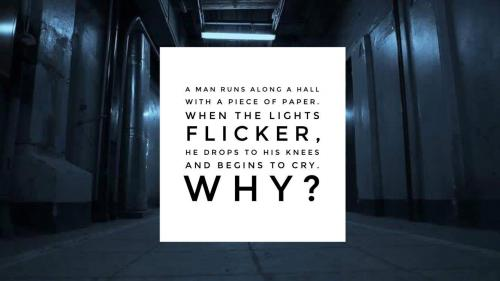 A man runs along a hall with a piece of paper. When the lights flicker, he drops to his knees and begins to cry. Why?