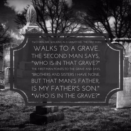 Two men are walking in a graveyard. The first man walks to a grave. 