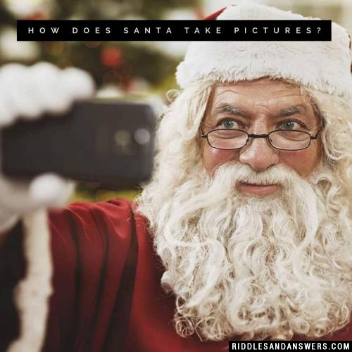 How does Santa take pictures?