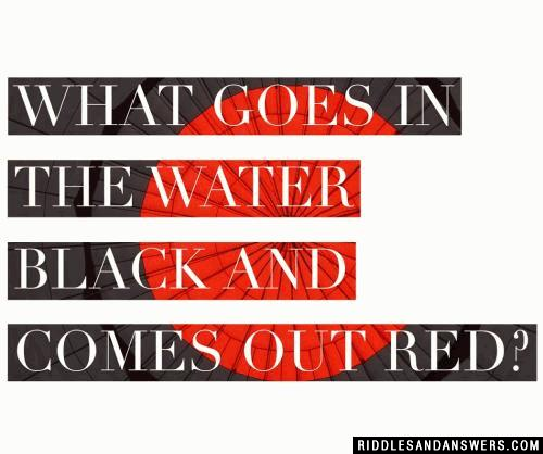What goes in the water black and comes out red?